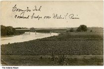 """Image of Covered bridge over the Wabash River, Covington, Indiana, October 1907 - Postmarked October, 1907.  The handwritten caption reads """"Covington Ind., covered bridge over Wabash River."""" Farmland is seen in the foreground."""