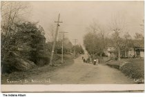 Image of Group walking past houses on Summit Street, Attica, Indiana, ca. 1910