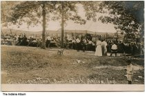 Image of Chautauqua tent at Ravine Park, Attica, Indiana, ca. 1910 - Groups of people are seen by a large tent.