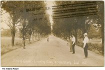 Image of Sterling Grade looking east, Veedersburg, Indiana, ca. 1910 - Four men and two boys stand on a dirt road under a canopy of trees. Postmarked January 17, 1910.