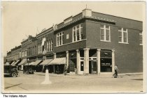 Image of Post Office and local businesses, Bloomfield, Indiana, ca. 1925 - Signs are seen for the Post Office, Ganley (Gamley?) Kitchen Ice Cream shop, IOOF (Odd Fellows) and Rebekah reception hall. There appears to be a Masonic symbol on the building that houses the Post Office.