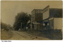 Image of People standing in front of businesses in Trinity Springs, Indiana, ca. 1908 - Postmarked July 29, 1908. Signs for Silvers & Son General Merchandise,  J. O. Dollens General Store, and Henry George Cigars are seen.
