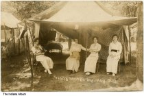 "Image of Four women in a tent at a campground, Trinity Springs, Indiana, 1913 - The caption reads ""Trinity Springs, Ind. Aug. 7-13."""