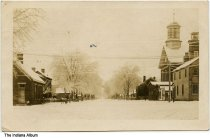 Image of Snow and ice covered residential street, Rising Sun, Indiana, ca. 1907 - Postmarked August, 1907.