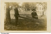 Image of Men with wheelbarrow by a church, possibly Parke County, Indiana, ca. 1910 - The church in the background is also seen in ia-0214-0881.