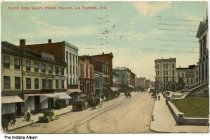 Image of Stores on the north side of the Square, Lafayette, Indiana, ca. 1912 - Postmarked August 22, 1912. Signs are seen for Taylor-Steffan, National Bank, a shoe store, a drugstore, and The Baltimore.