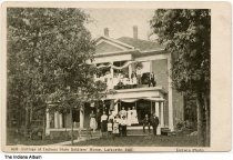 """Image of Indiana State Soldiers' Home, Lafayette, Indiana, ca. 1905 - A group of people are seen by a two story housing unit marked """"Grant G."""""""