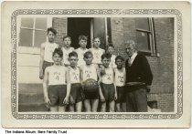 "Image of School basketball players and coach, Wright Township, Indiana, ca. 1931 - Ten boys who are high school age or younger are seen with their coach. The boys are in basketball uniforms that read ""No. 4"" and one holds a  basketball reading ""No. 4 1931-2."" On the back is treads ""Frank Fortner"". Francis M. Fortner  (1881-1953) was listed as a schoolteacher in Jasonville, Indiana in the 1940 census. 