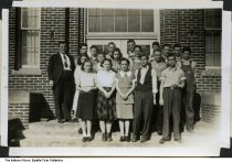 Image of Hazleton High School sophomore class, Hazleton, Indiana, 1940 - Left to right, front row: Marjorie Mallory, Mae Griesener, Helen Lane, George Kerr, Carol SMith. Middel row: Vonnie Jean Ropp, Helen Turbett, Maxine Still, Leslie Sullivan, William Decker, Leonard Jones. Back row: Allen Thorne (sponsor), Forrest Western, James Stiles, Junior Scott, Jack Sanders, Ival Maxwell, John Selby, Randall Morrison.   This image was part of a homemade yearbook made for and by Hazleton High School students. Please see ia-0231-0024 to view the entire yearbook.