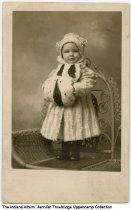 Image of Robert Thomas Williams as a child, Washington, Indiana, ca. 1909 - The toddler boy wears a fur coat and carries  a fur muff.