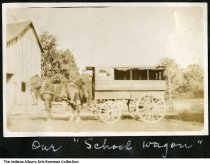 "Image of George A. Cosgrove and the township school wagon, Montgomery, Indiana, ca. 1920 - Montgomery is in Barr Township, Daviess County. This horse-drawn wagon reads ""Township Schools"" on the side."