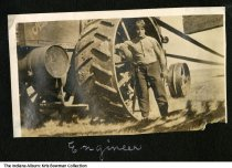 Image of George A. Cosgrove repairing machinery, Indiana, ca. 1920 - The photo may have been taken on the Cosgrove family farm in Montgomery.