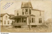 """Image of House damaged by a tornado, New Castle, Indiana, March, 1917 - On the front is written """"Tornado of March 11, 1917, New Castle, Ind.""""."""