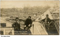 """Image of Greenhouses destroyed by a tornado, New Castle, Indiana, March, 1917 - Three men stand amid the rubble of a greenhouse destroyed in a tornado. The caption reads """"Berithey's Green Houses - Tornado of Mar 11, 1917 New Castle, Ind."""""""