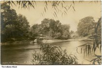 """Image of Ford in the Tippecanoe River, Winamac, Indiana, ca. 1908 - Postmarked November 25, 1908. The caption appears to read """"Perl St. Ford."""""""