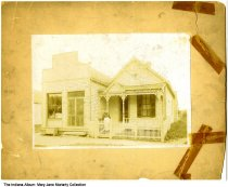 """Image of Moriarty grocery store and home, Indianapolis, Indiana, ca. 1895 - On the back it reads """"The original home and grocery store - Patrick and Mary M."""" (Moriarty). The address on the store is """"333"""" - these buildings may have been located at 333 Minnesota Street, and torn down to build the two stry home seen at ia-0033-0013."""