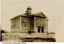 Image of Man in front of the High School, Burkett, Indiana, ca. 1909 - Postmarked May 3, 1909.