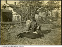 Image of Romie Michael Sefton with a hog, Greensburg, Indiana, ca. 1910 - High school student Mary Ida Sefton took this picture with a Brownie camera that her twin, Ruth Edna Sefton (b. 1893), won in a writing contest. Sefton Farm was located northwest of Greenburg on the site later occupied by the Honda plant.