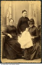 Image of Three women and an infant, Fort Wayne, Indiana, 1889 - The infant seen here is identified on the back as Donald Guild Crighton (b. 18 January 1889 in Fort Wayne, d. 8 January 1950). He was the son of David Kennedy Crighton and Caroline Frances Guild (1868-1946, seen holding her son). Also seen are Caroline's stepmother Helen Frances Grinnell (b. 1840) and Melinda W. Emerson (b. 1816), Caroline's grandmother. Photographed by Shoaff of Fort Wayne and dated March 23, 1889.