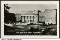 """Image of Shortridge High School, Indianapolis, Indiana, ca. 1936 - One of the other images in the series advertises the W. C. Fields movie """"Mississippi,"""" released in 1935. See ia-0001-1732 to ia-0001-1756 for other photographs in this collection."""