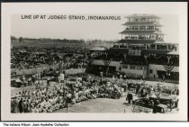 "Image of Crowd at Indianapolis Motor Speedway, Speedway, Indiana, ca. 1936 - A crowd is seen at the Pagoda and Judge's Stand. One of the other images in the series advertises the W. C. Fields movie ""Mississippi"", released in 1935. See ia-0001-1732 to ia-0001-1756 for other photographs in this collection."