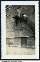 """Image of Girl standing on on stairs or a fire escape, probably Avilla, Indiana, 1937 - Stamped """"Waitneck Photo Service - April 5 1937 - Elkhart, Indiana"""" on the back. Another photo from this collection was of a classroom in Avilla."""