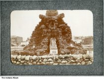 Image of McGregor Fountain, Indianapolis, Indiana, ca. 1900 - This fountain was built on the north lawn of the Marion County Courthouse in 1899. Signs are seen for C. E. Shover Cold Storage, F. Kremp Saloon, and Scovill & Co. Livery & Sale Barn -- all located on North Alabama Street north of Washington Street.