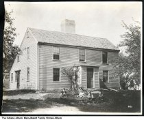 Image of Family in front of a salt box style house, Indianapolis, Indiana, ca. 1870