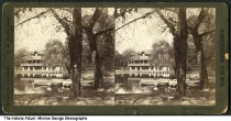 """Image of Large boathouse on a small lake, Indianapolis, Indiana, ca. 1900 - This stereoview is No. 1845; the caption reads """"Across the Pond."""""""