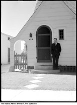 Image of Man in front of a white house, Indiana, 1938 - Notation on envelope: 454 Mandolay Blvd., W. T. & M. S. Fox