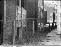 Image of Fence between tow houses near a church, Indiana, 1940 - Notation on envelope: Orville T. and Margaret Jean Fox