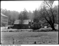 Image of Pioneer buildings at Spring Mill State Park, Mitchell, Indiana, 1939 - Notation on envelope: Village and Large Willow -- Spring Mill