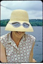 Image of Woman in a sunglasses hat by a lake, Chesterton, Indiana, 1954 -
