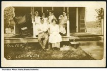 "Image of Group on cabin porch, Long Point, Lake Maxinkuckee, Culver, Indiana, ca. 1915 - On the front it reads ""Culver"" and ""Longpoint."""