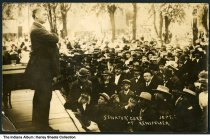 """Image of Speech by Oklahoma Senator Thomas Pryor Gore, Rensselaer, Indiana, 1908 - A crowd watches a man speaking from a stage. The postcard is captioned """"Senator Gore at Rensselaer / Sept."""" Oklahoma Senator Thomas Pryor Gore, """"the blind statesman,"""" spoke along with Thomas R. Marshall, then candidate for Governor of Indiana, at a Democratic rally at Rensselaer on September 2, 1908. [Source: The Alexandria Times-Tribune, September 2, 1908, p. 1]"""