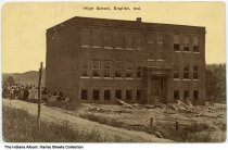 Image of High School, English, Indiana, ca. 1915 - Postmarked July 7, 1915. The school appears to still be under construction.