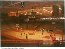 """Image of Interior of the Huntingburg High School gymnasium, Huntingburg, Indiana, ca. 1990 - Male students during basketball practice. Signs read """"Final Four 1986"""" and """"Final Four 1985."""""""