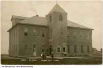 Image of Woman and children in front of the High School, Kempton, Indiana, ca. 1910 -