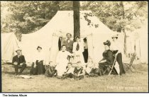 """Image of Family in front of a tent, Camargo, Illinois, ca. 1910 - The location of this series of about 39 postcards was not identified; two of the postcards show a building marked """"Patterson Springs,"""" located at the Chautauqua in Patterson Springs, Illinois."""