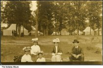 """Image of Women with ornate hats at a campground, Camargo, Illinois, ca. 1910 - The location of this series of about 39 postcards was not identified; two of the postcards show a building marked """"Patterson Springs"""", located at the Chautauqua in Patterson Springs, Illinois."""