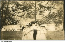 """Image of Women posing by a river, Camargo, Illinois, ca. 1910 - The location of this series of about 39 postcards was not identified; two of the postcards show a building marked """"Patterson Springs,"""" located at the Chautauqua in Patterson Springs, Illinois."""