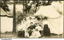 """Image of Group posed outside a tent, Camargo, Illinois, ca. 1910 - The location of this series of about 39 postcards was not identified; two of the postcards show a building marked """"Patterson Springs,"""" located at the Chautauqua in Patterson Springs, Illinois."""