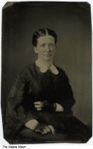 Image of Portrait of Nancy (Eastman) Ross, Ohio, ca. 1875 - Mrs. Ross is wearing lacy fingerless gloves and a white lace collar. 