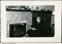 """Image of Woman seated by a fireplace, Indiana, ca. 1940 - On the back it reads """"Grandpa Wetzel's mom""""."""