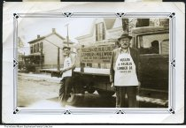 Image of Owners of Mullen & Helblig Lumber, Anderson, Indiana, 1936 - Cecil Mullen (left) and Mr. Helblig are seen by their delivery truck. The business was located at 409 Meridian Street in Anderson. The photo is time stamped July 24, 1936.