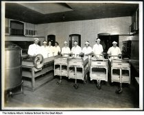 Image of Food service workers at the Indiana School for the Deaf, Indianapolis, Indiana, ca. 1923 - The workers are seen inside the kitchen.