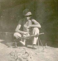 Image of Leverette V. Pierce with Japanese Light Machine Gun - P1977.1.2