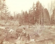Image of Two Hunters by a River