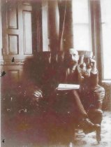 Image of Edgar P. Sawyer Smoking a Pipe - P2001.1.37