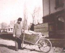 Image of Workman at Edgar Philetus Sawyer's First House - P2001.1.399